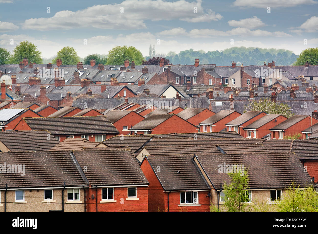 Urban scene across built up area showing the slate roof tops of terraced houses on an old housing estate - Stock Image