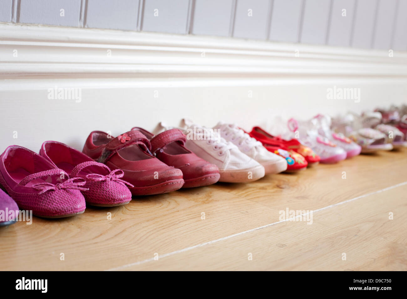 Child's shoes in a row - Stock Image