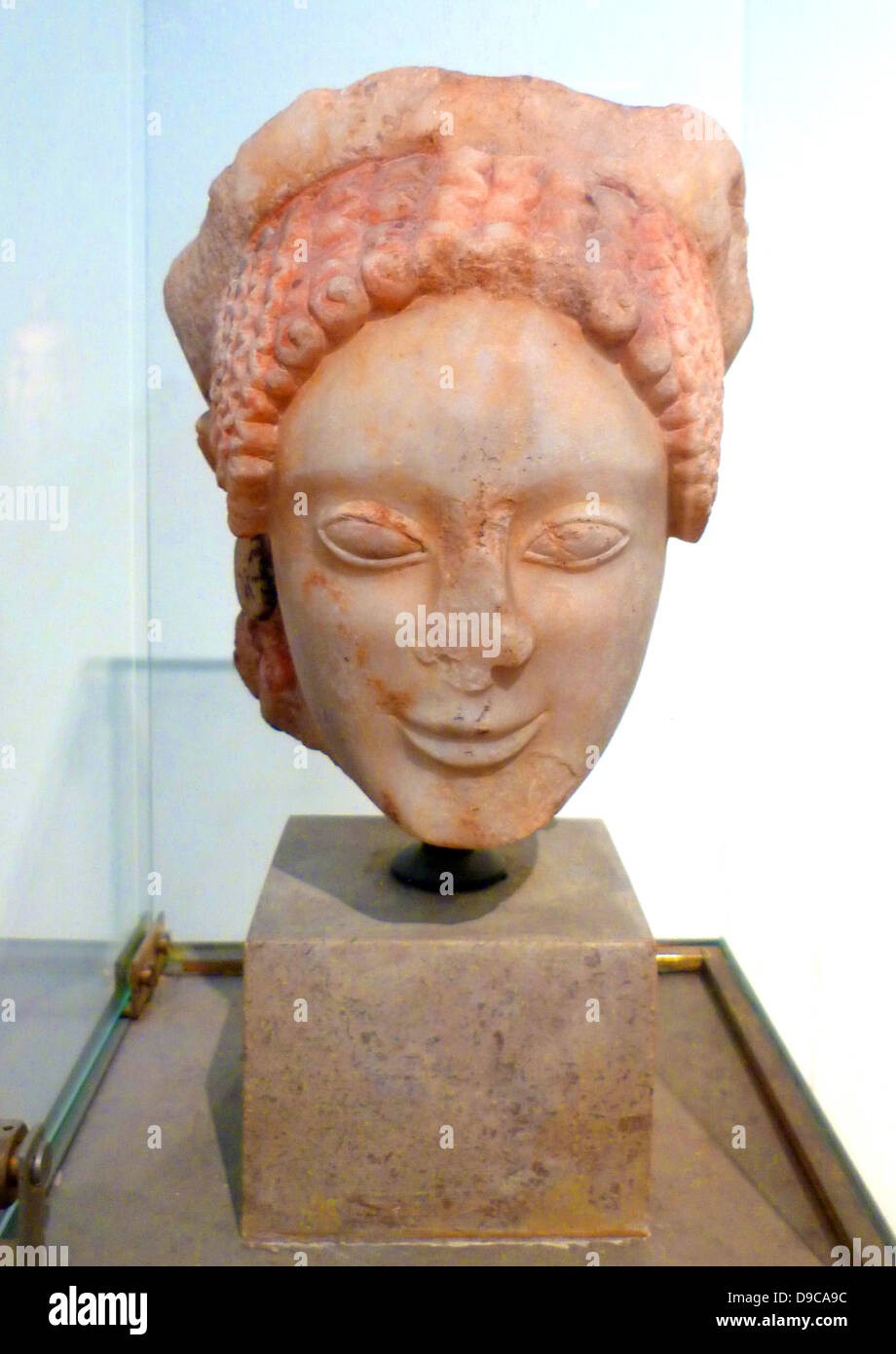 Top of a youth, marble. Found in Eleusis. It probably belongs to the statue of a rider. About 560 BC. Stock Photo