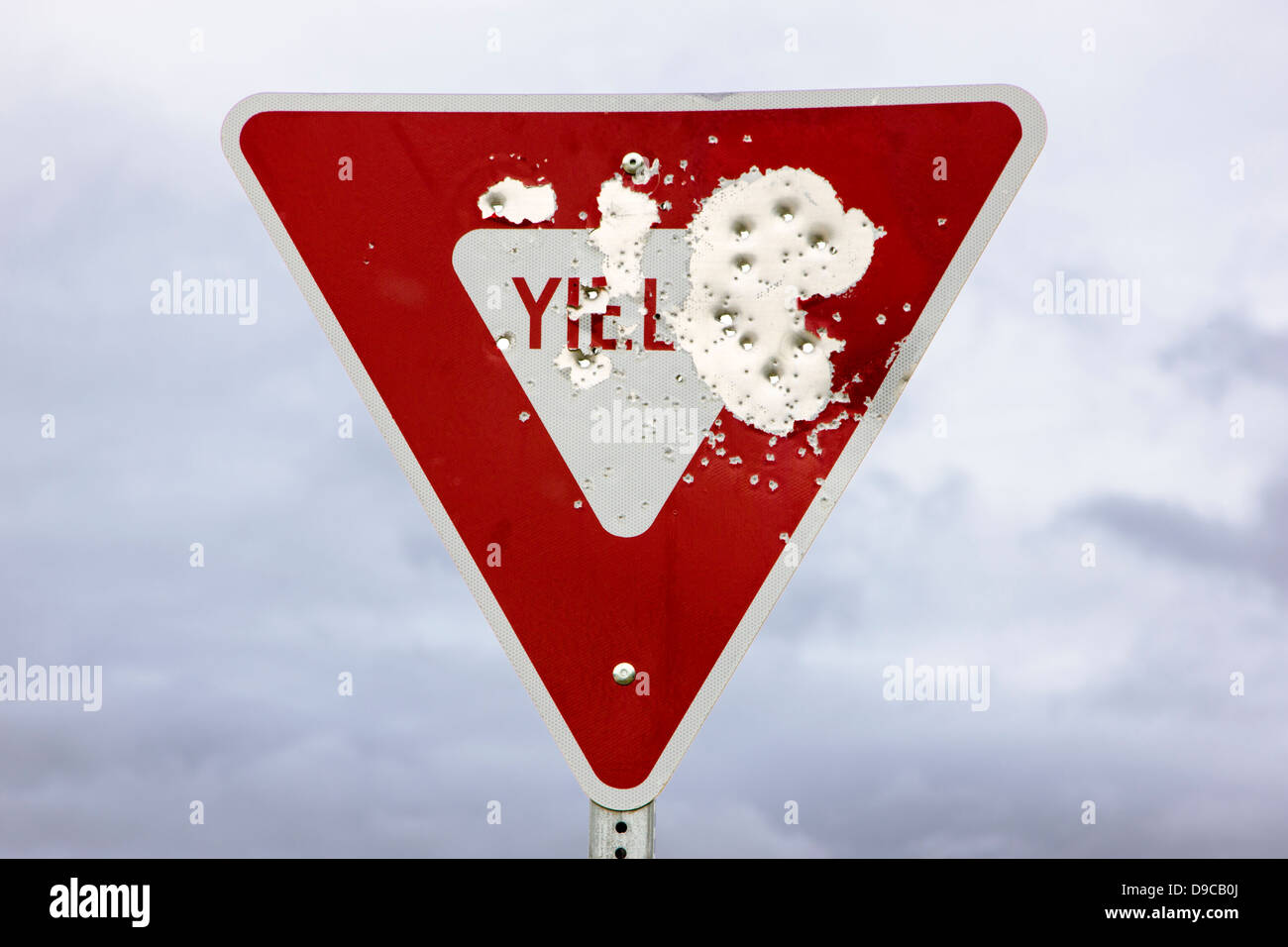Yield sign with bullet holes, Kuskulana Bridge, c1910, built by Copper River & Northwest Railroad to access - Stock Image