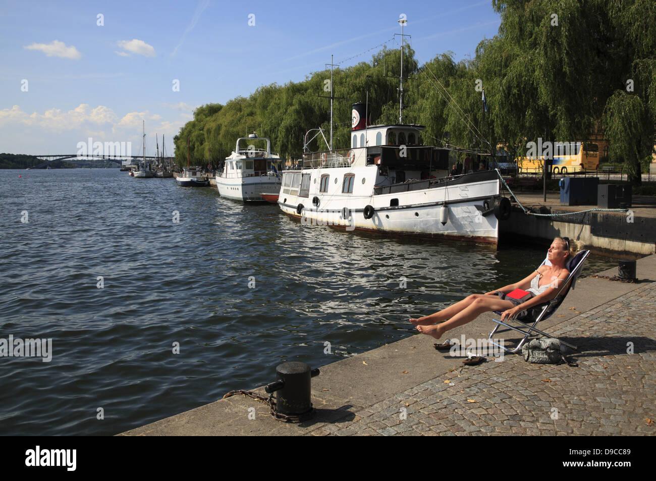 Sunbath at am Riddarfjaerden, Stockholm, Sweden, Scandinavia - Stock Image