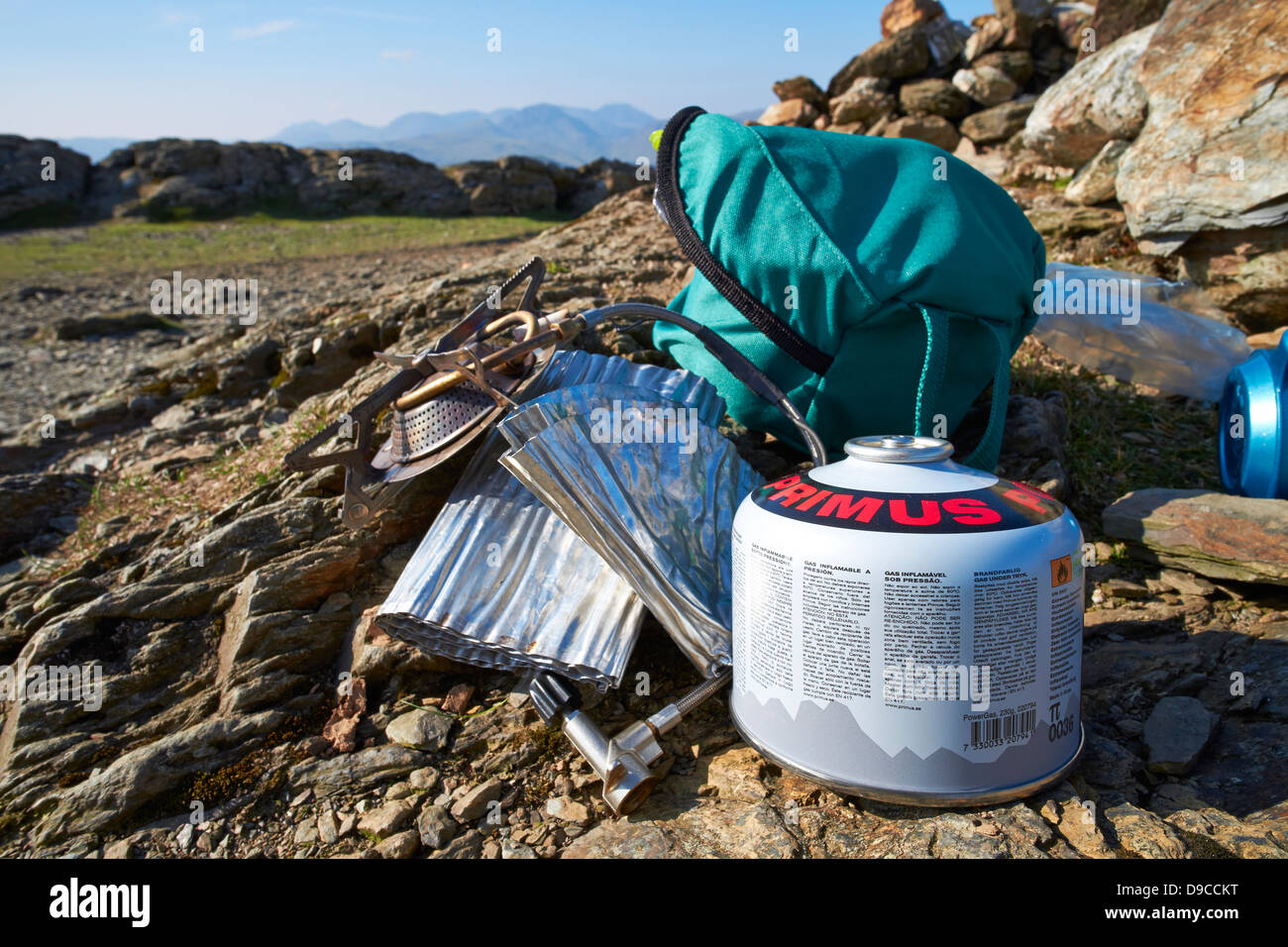 Camping stove, gas and pans on the summit of a Robinson in the Lake District. - Stock Image