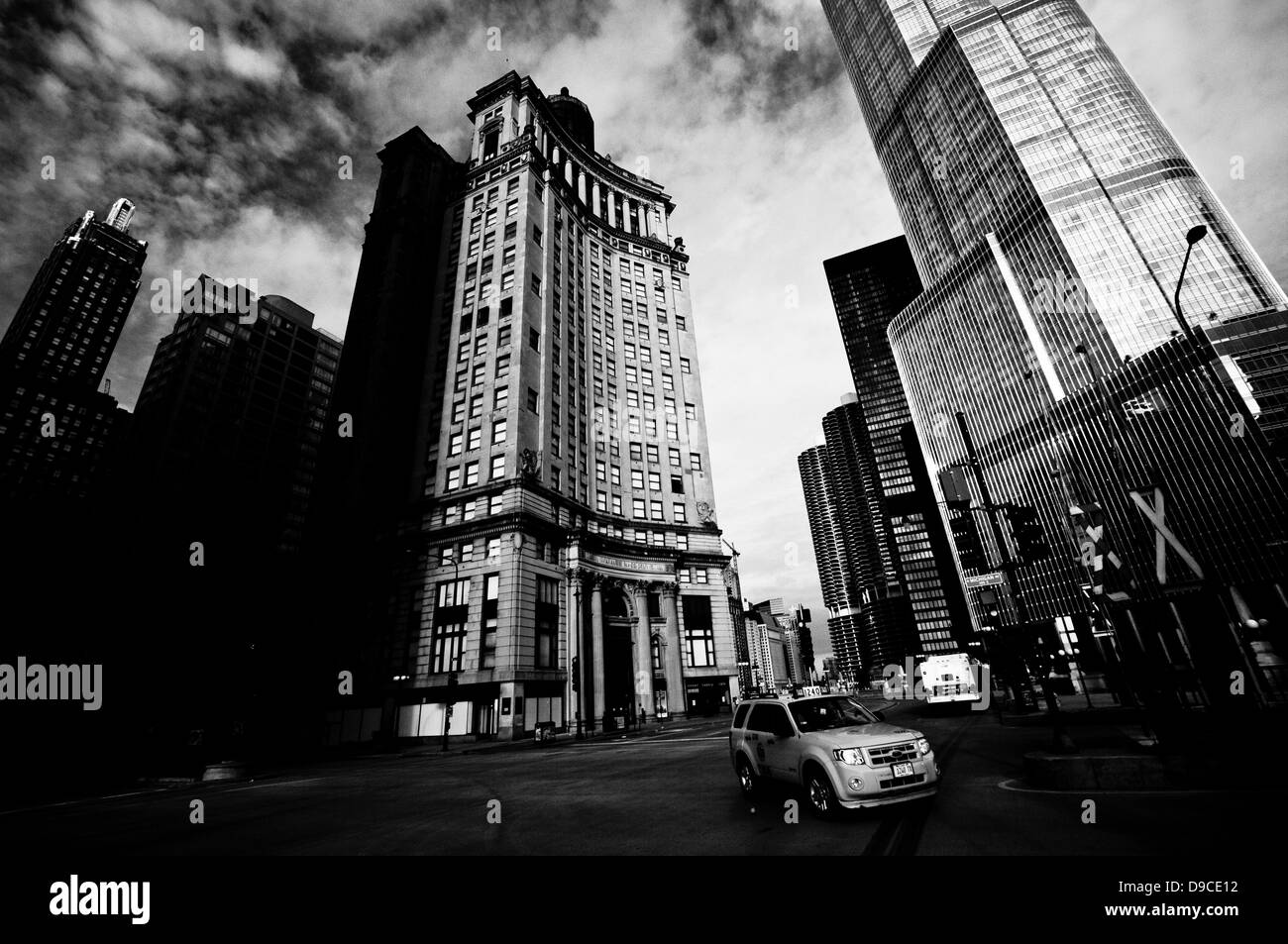 Downtown Chicago as seen from North Michigan Avenue - London Guarantee Building on the left & Trump Tower on - Stock Image