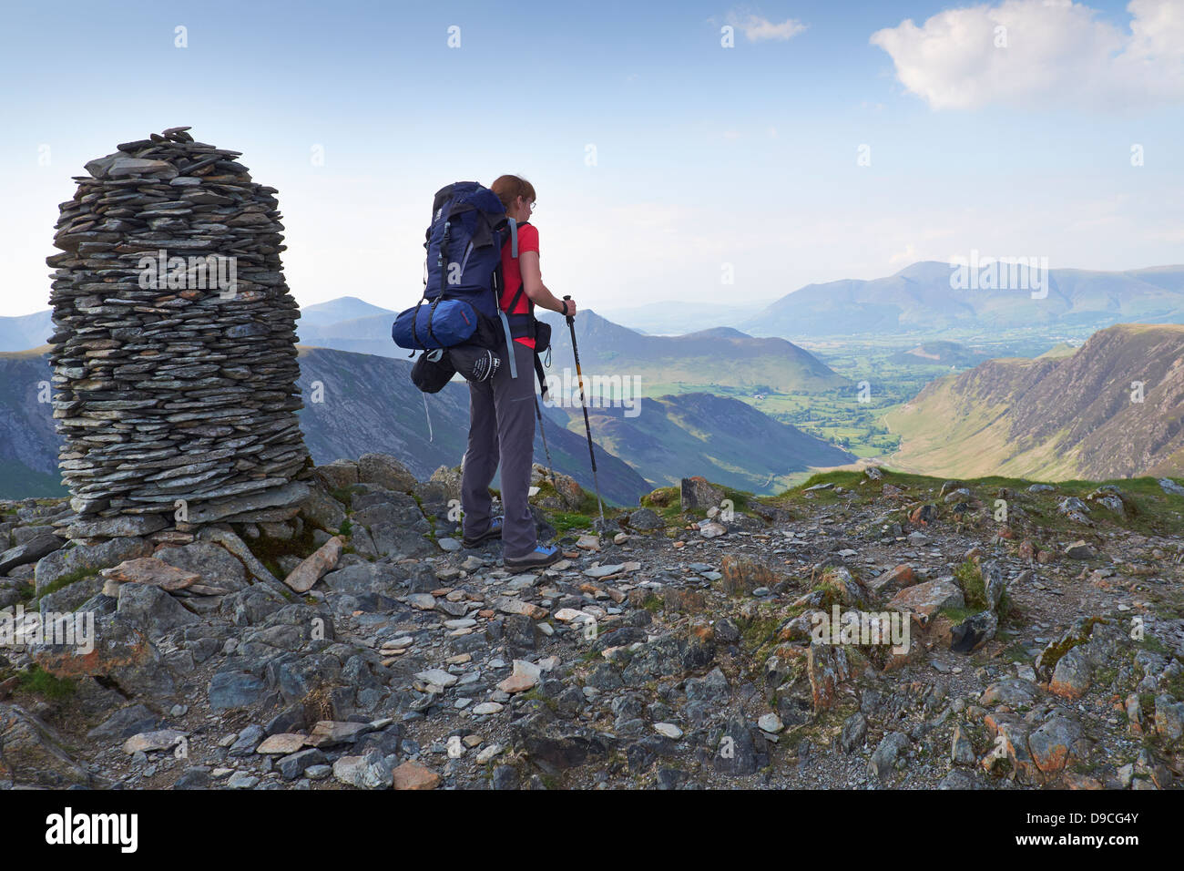 A hiker with a large backpack on the summit of Dale Head, Buttermere Fells in the Lake District. - Stock Image