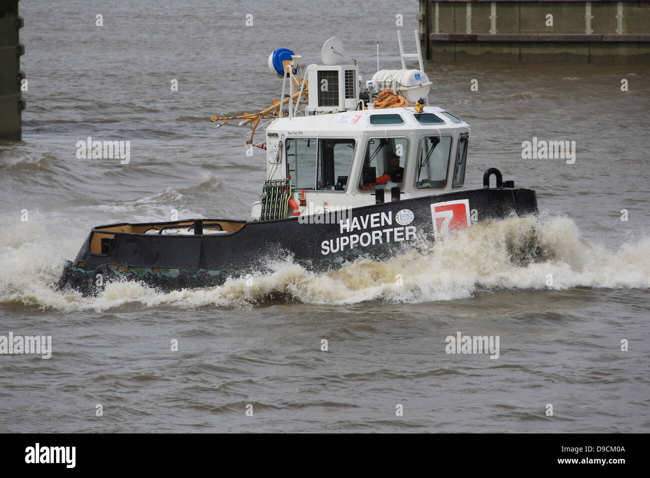 The Haven Supporter is on long term charter from Red 7 Marine The 'Stan Tug 1205' will be assisting Blackfriars - Stock Image