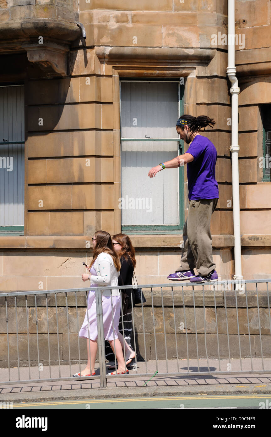 Young man practicing parkour on a Glasgow street. - Stock Image