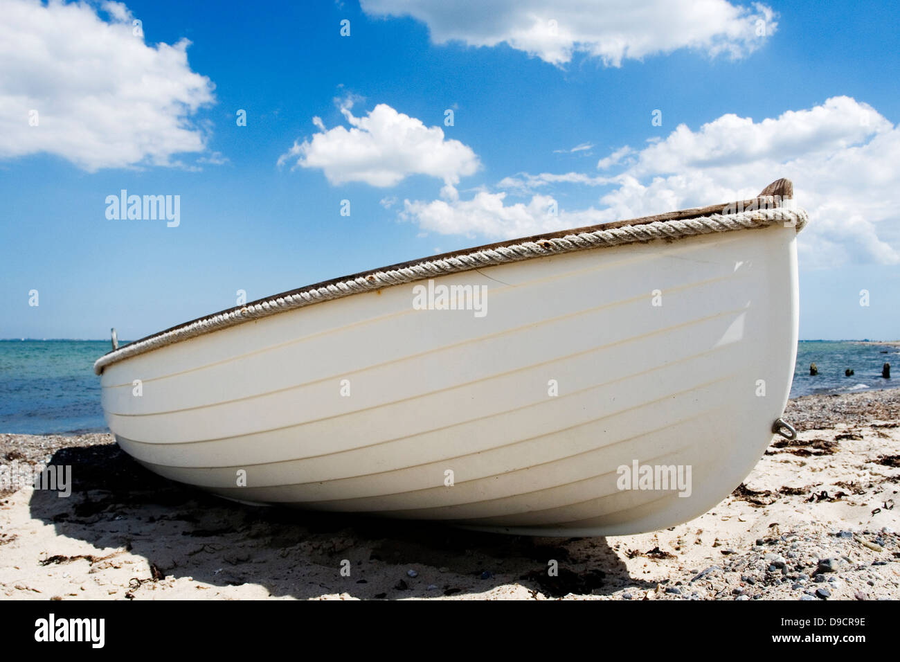 Oar boat on the Baltic beach - Stock Image