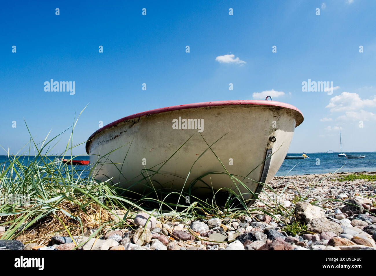 Oar boat on the beach - Stock Image