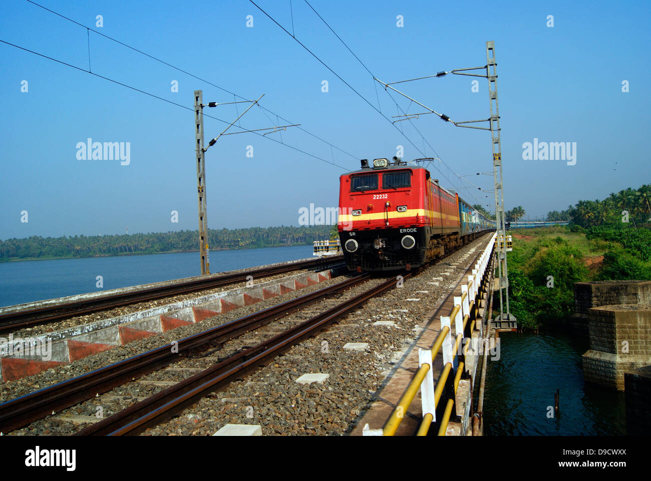 Indian Railways Electric Train Journey above the Backwaters of Kerala , India Stock Photo