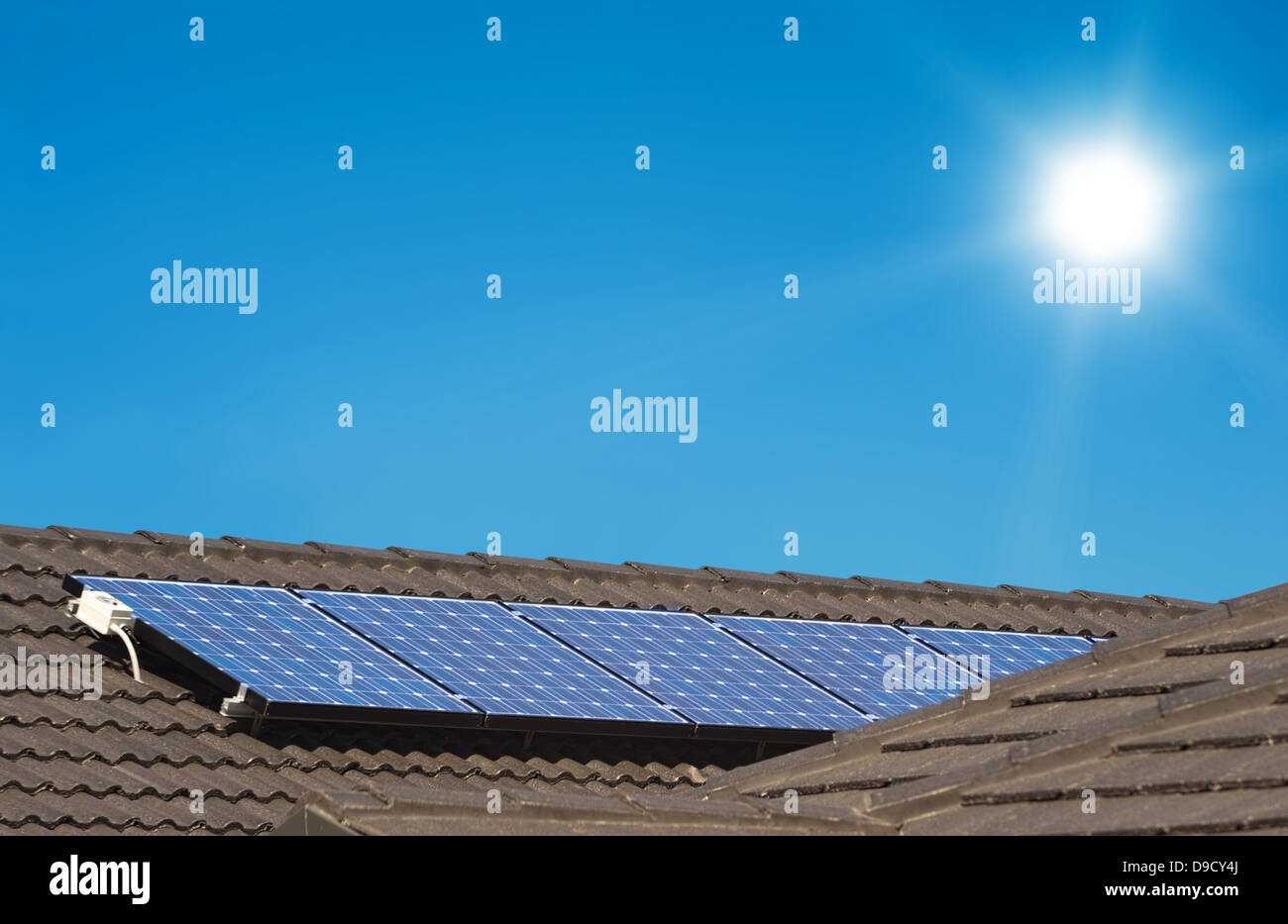 Solar panels on the roof of modern house - Stock Image