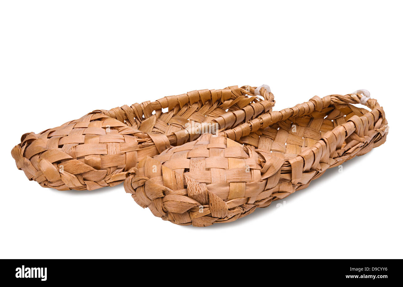 Old Russian bast shoes isolated on white background - Stock Image