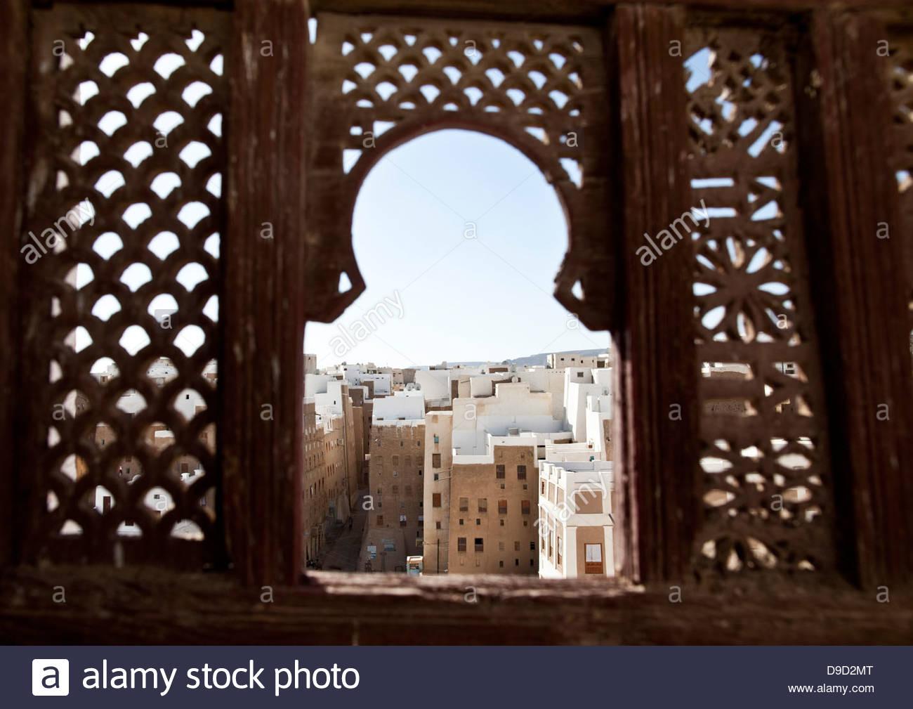 Apartments viewed through a window, Shibam, Hadhramaut, Yemen - Stock Image