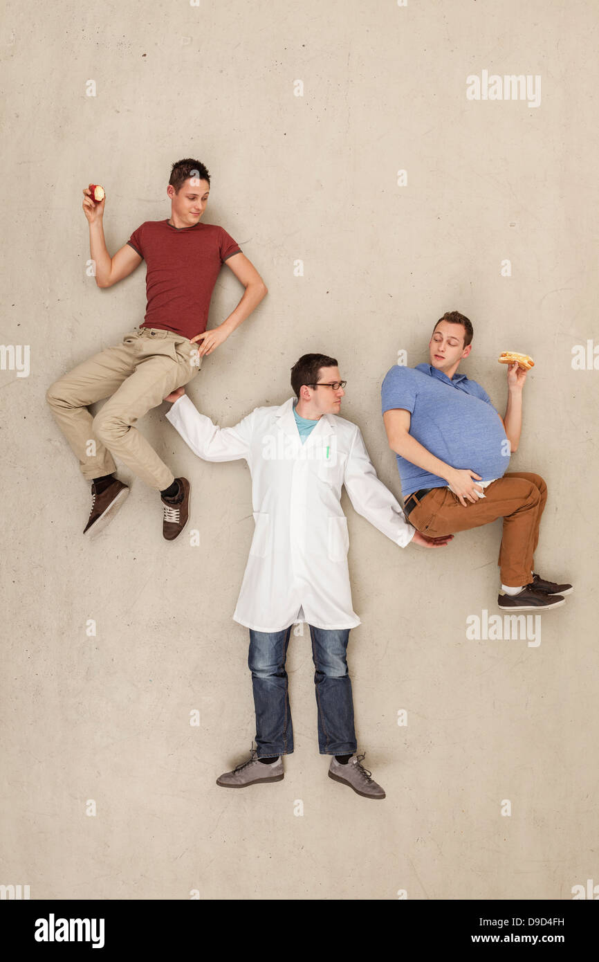 Man holding men in hands - Stock Image
