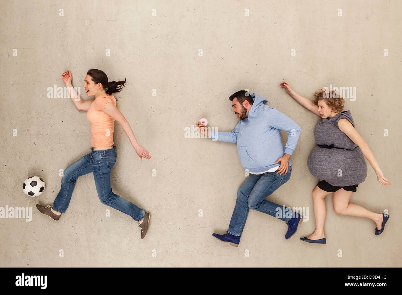Women and man running against beige background - Stock Image