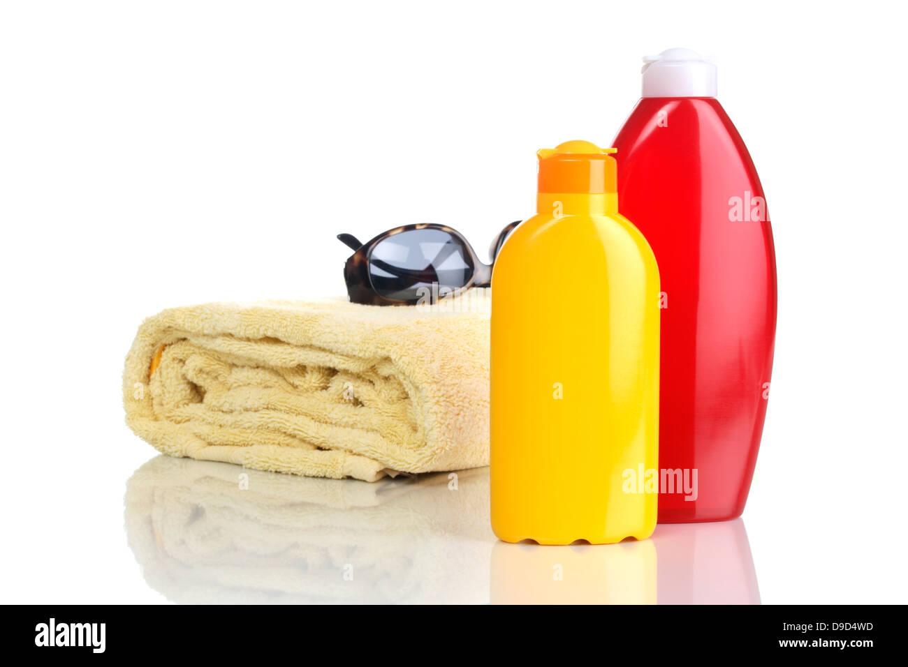 Towel, sunglasses and solar cream - Stock Image