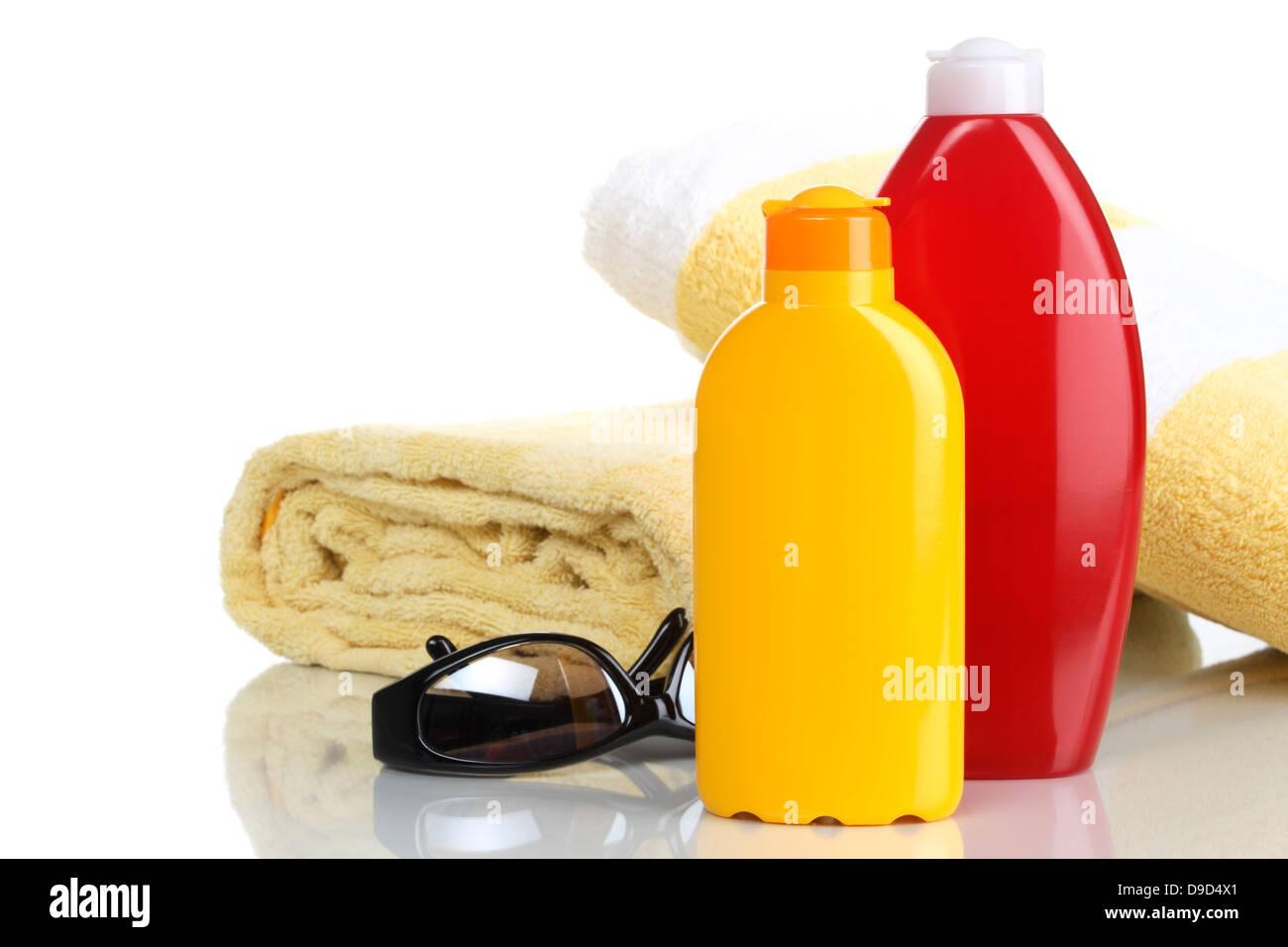 Bath sheets, sunglasses and solar cream - Stock Image