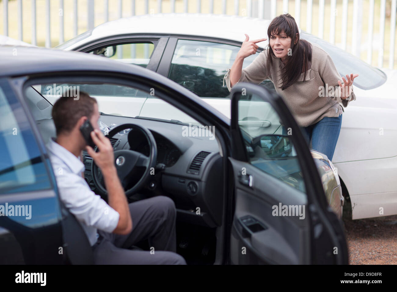 Woman reacting after car accident - Stock Image
