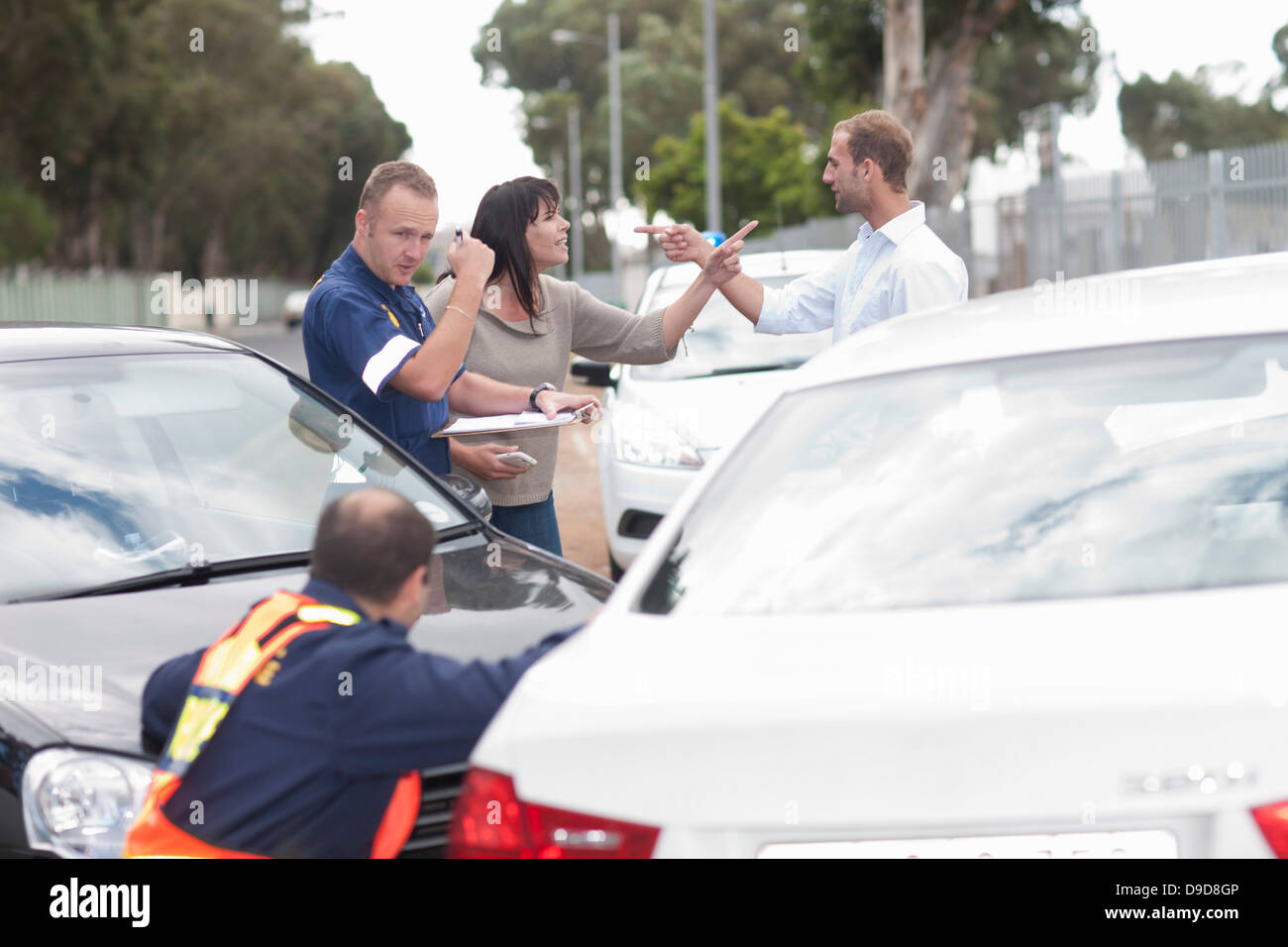 Drivers accusing each other at scene of car accident - Stock Image