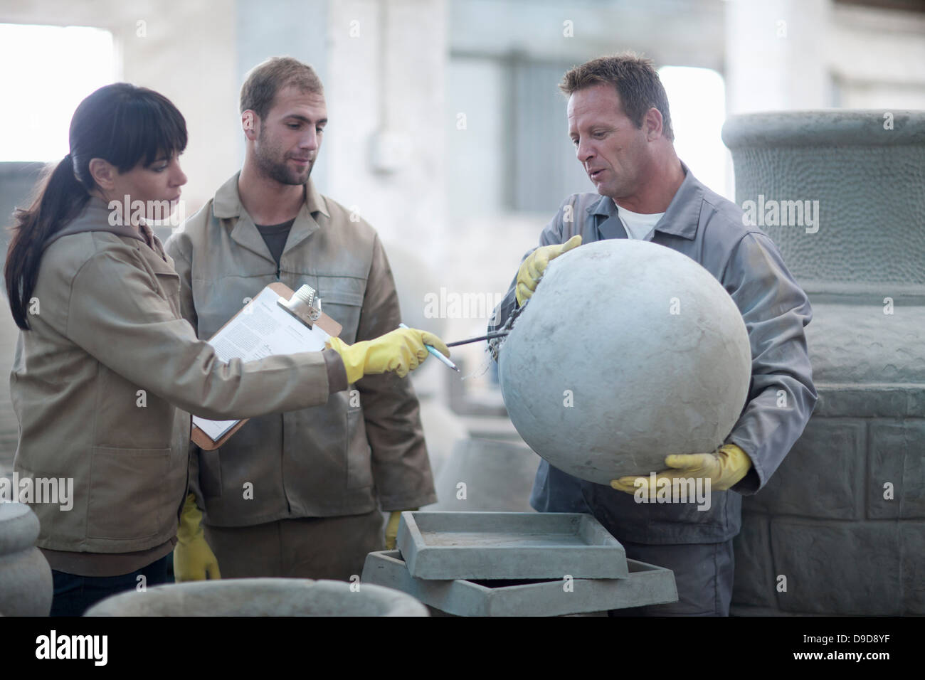 Dealing with sales in pottery factory - Stock Image