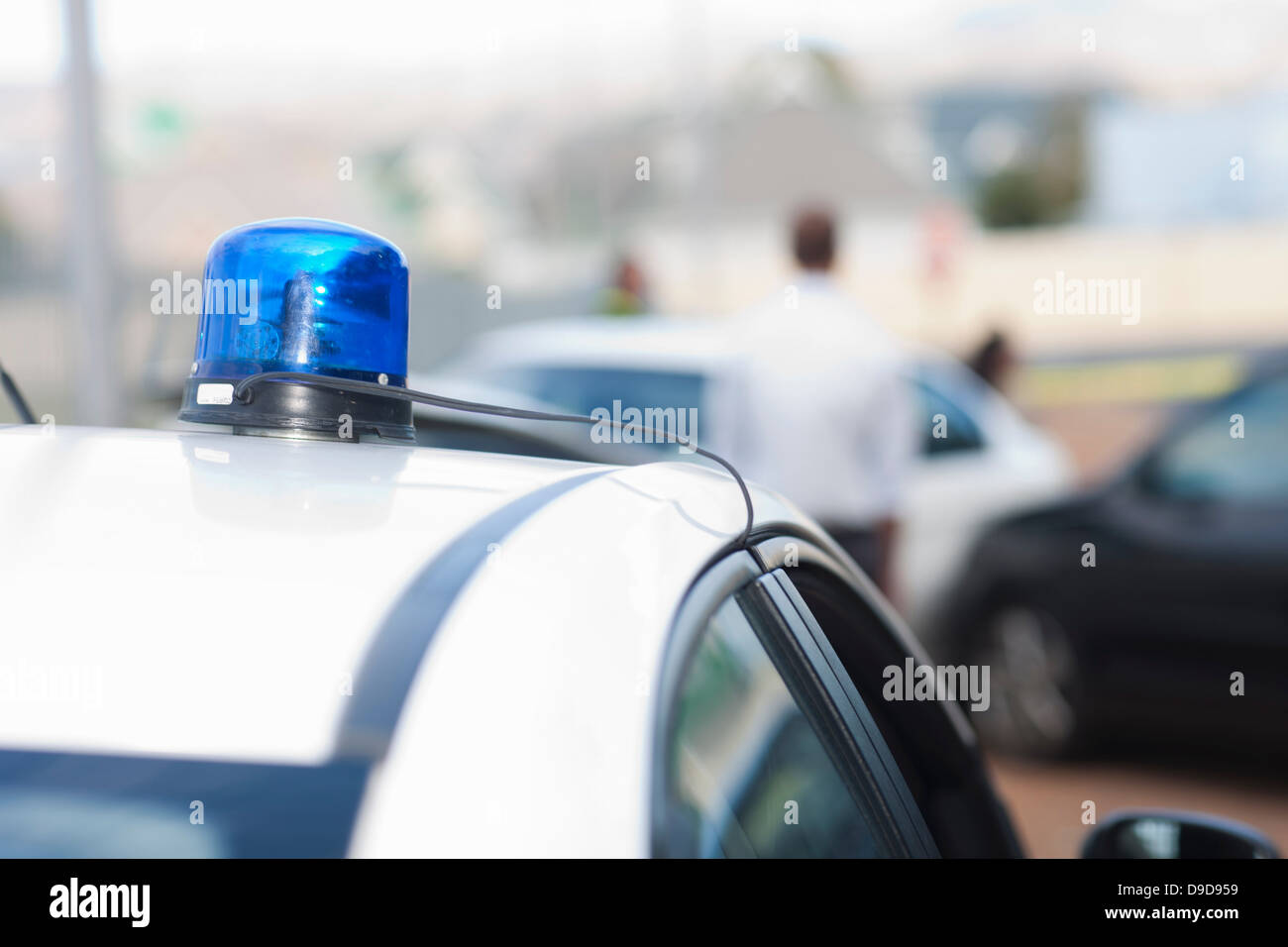 View of car accident scene from flashlights on police car - Stock Image