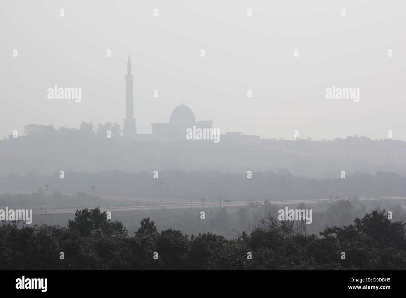 Bintan Island, Indonesia. 18th June, 2013. JUNE 18, 2013:A view of Mosque with haze air polution arrived in Bintan - Stock Image