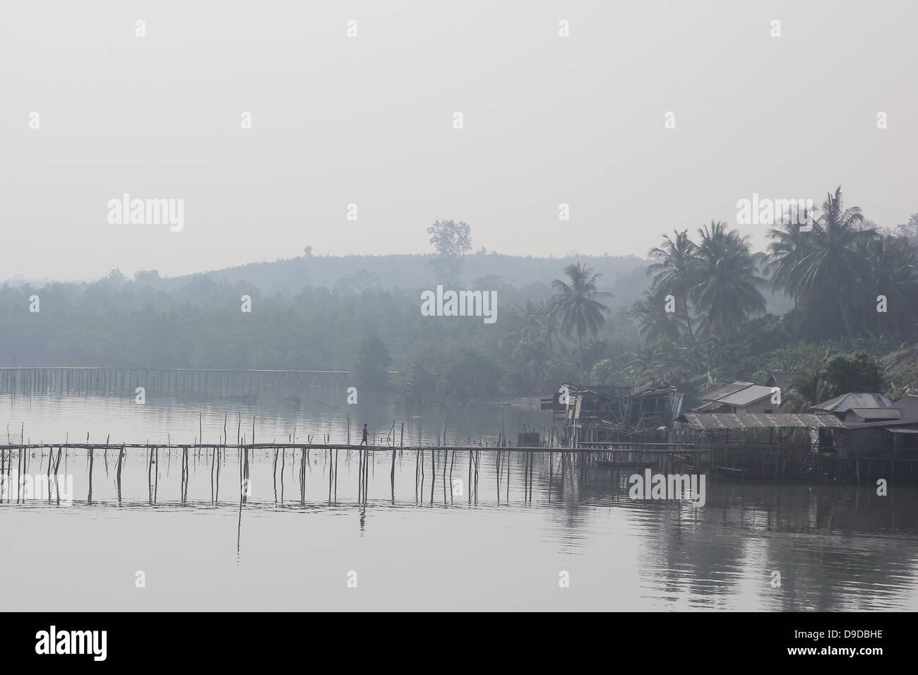 Bintan Island, Indonesia. 18th June, 2013. JUNE 18, 2013:A view of fisherman village with haze air polution arrived - Stock Image