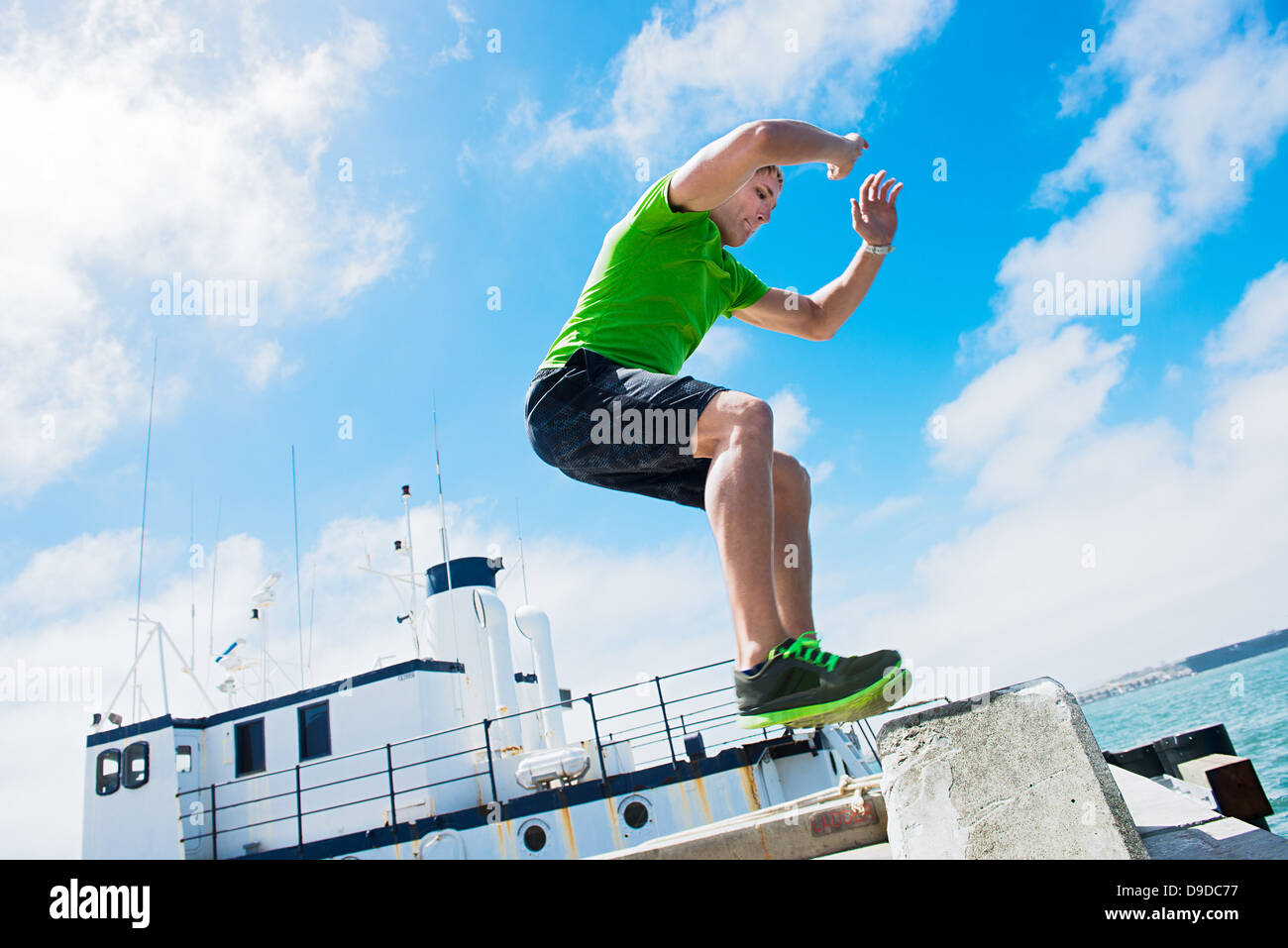 Young man jumping while fitness training - Stock Image