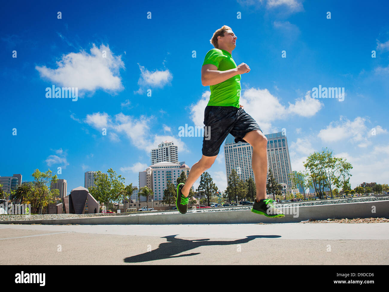 Young man jogging in city - Stock Image