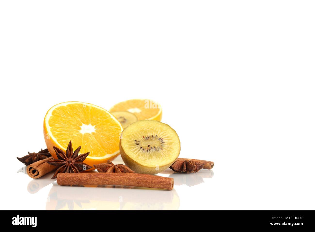 Orange, kiwi, cinnamon sticks and aniseed stars - Stock Image