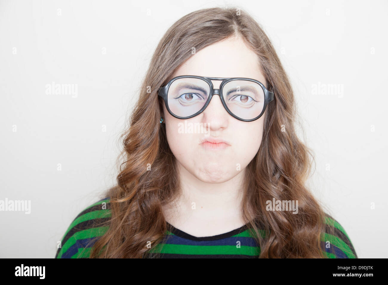 Girl wearing fake glasses - Stock Image