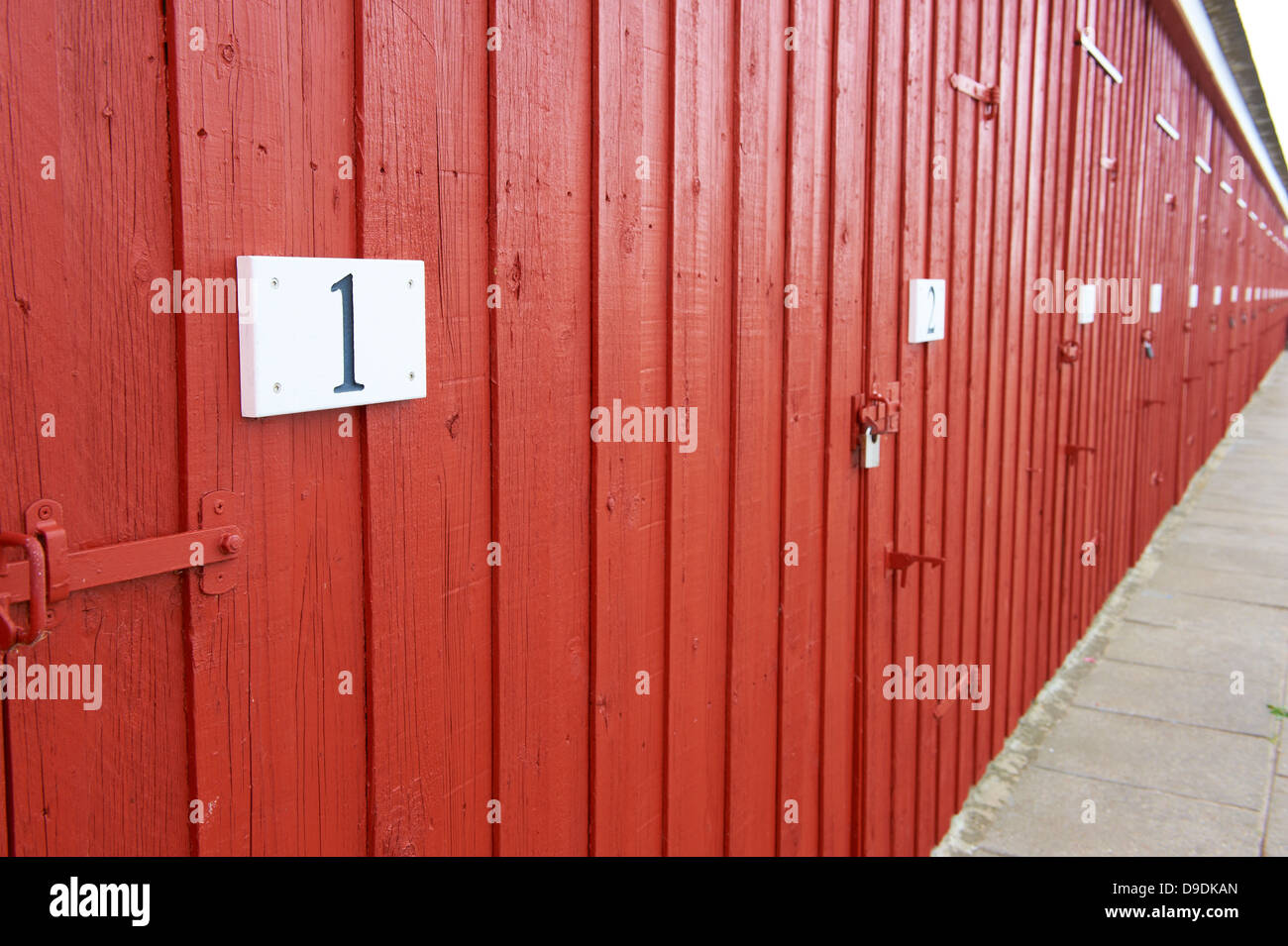 Red doors witn number signs - Stock Image