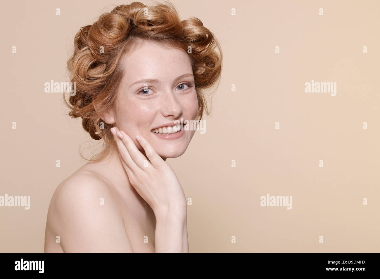 Young woman with curly red hair, portrait - Stock Image