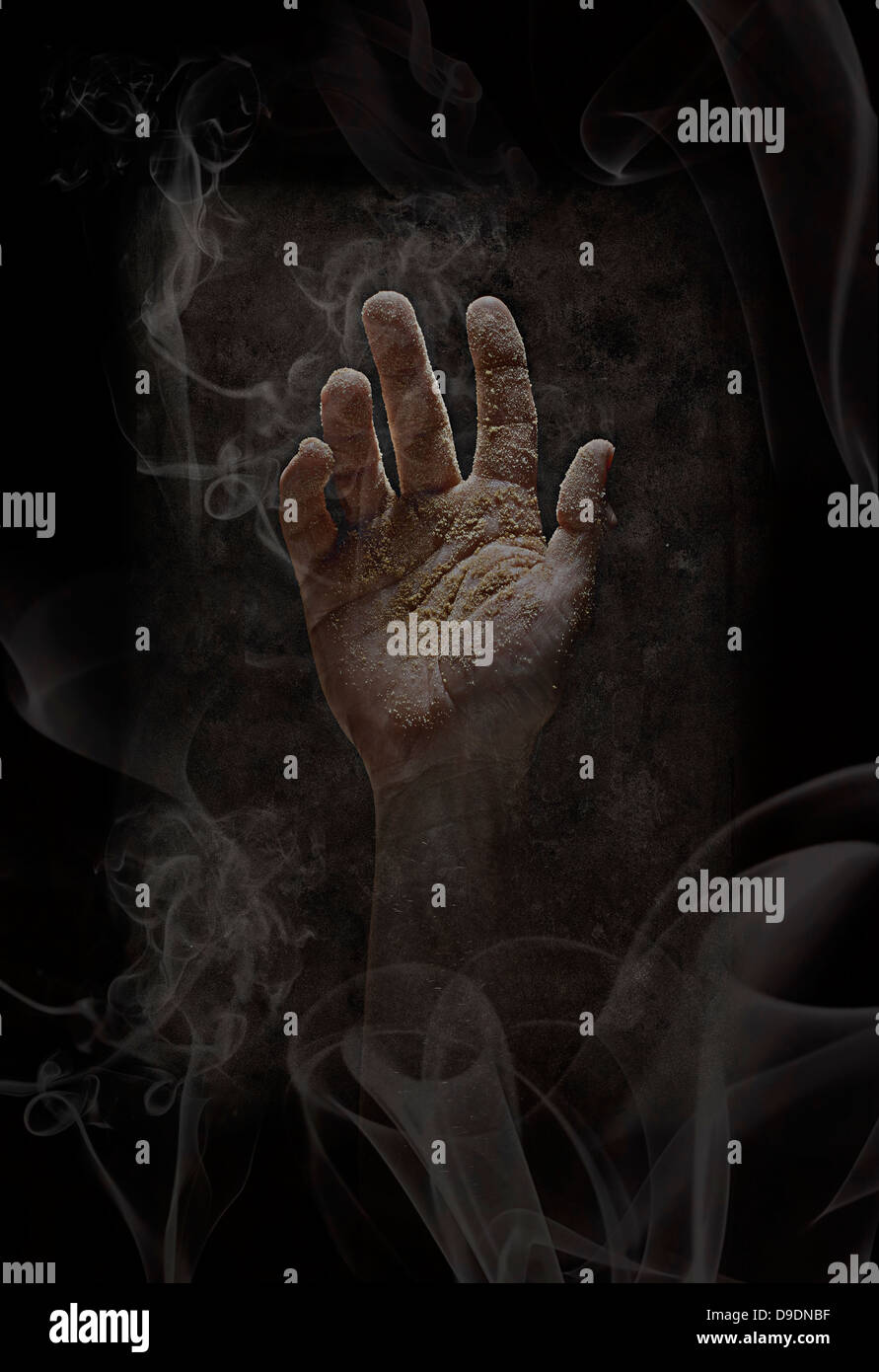 Dirty Hand Reaching Up - Stock Image