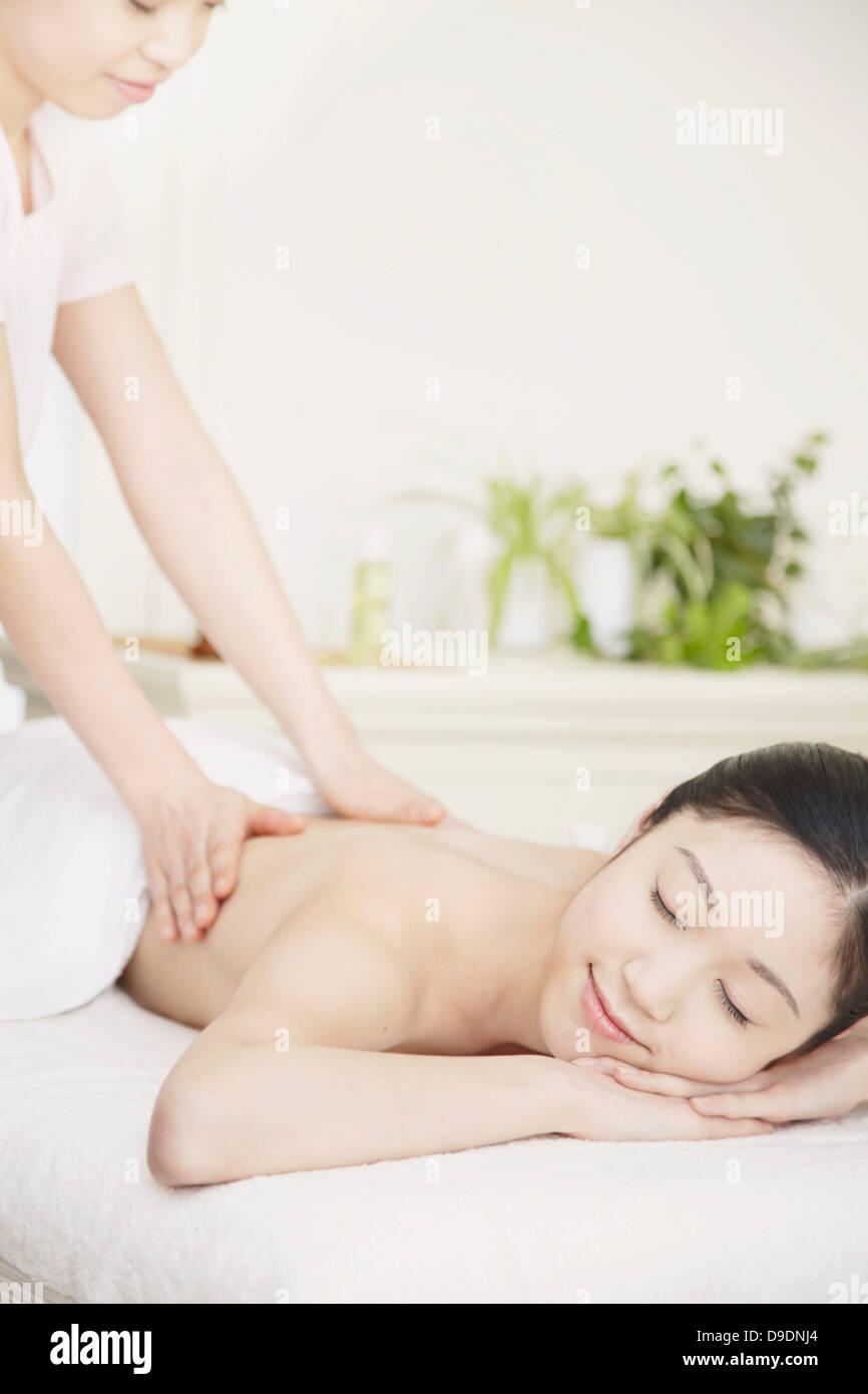 Woman having back massage - Stock Image