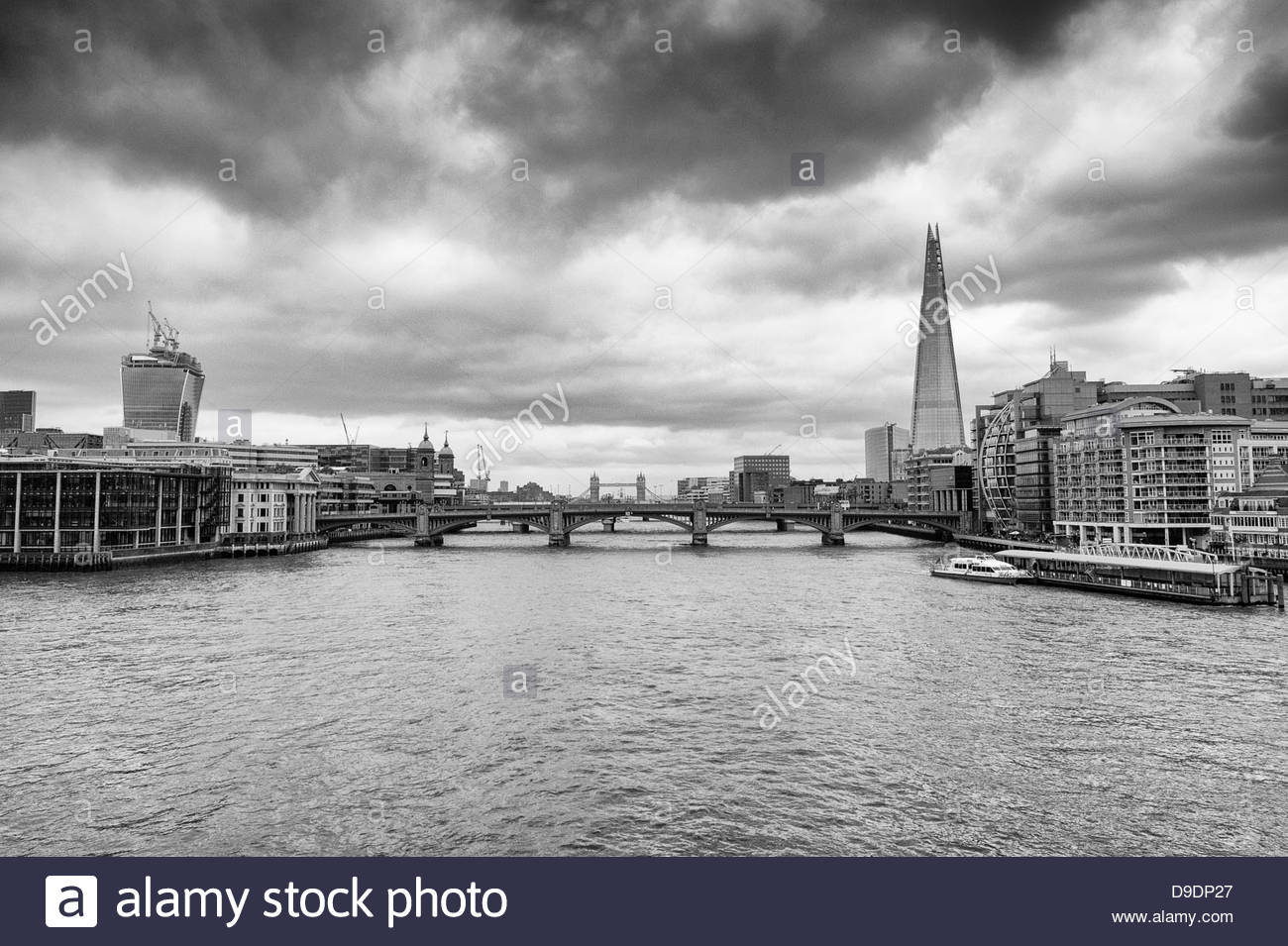 The River Thames, The Shard and City Skyline from the Millennium Bridge, London, England, United Kingdom 2013, Black - Stock Image