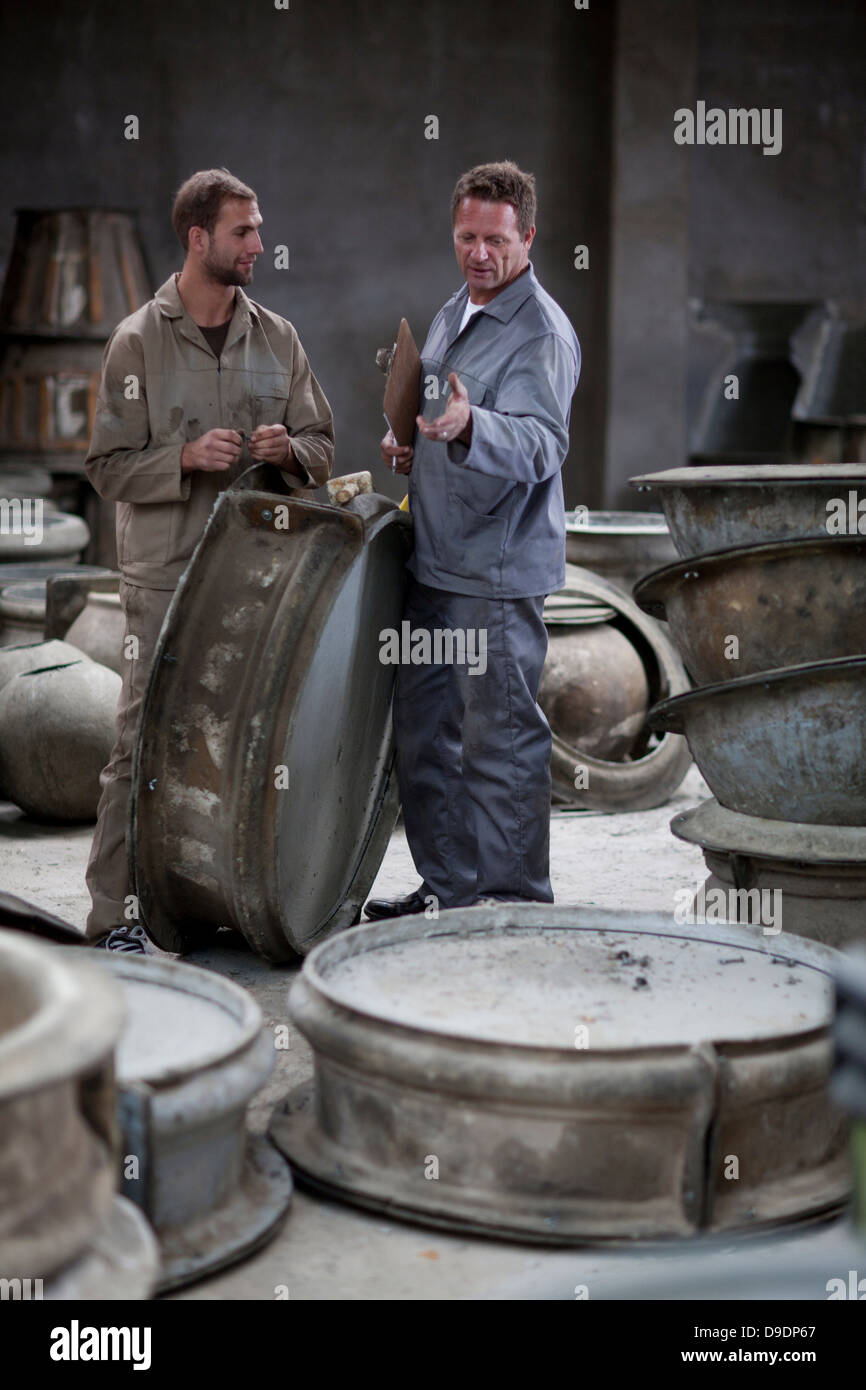 Fetching potters wheel at pottery factory - Stock Image