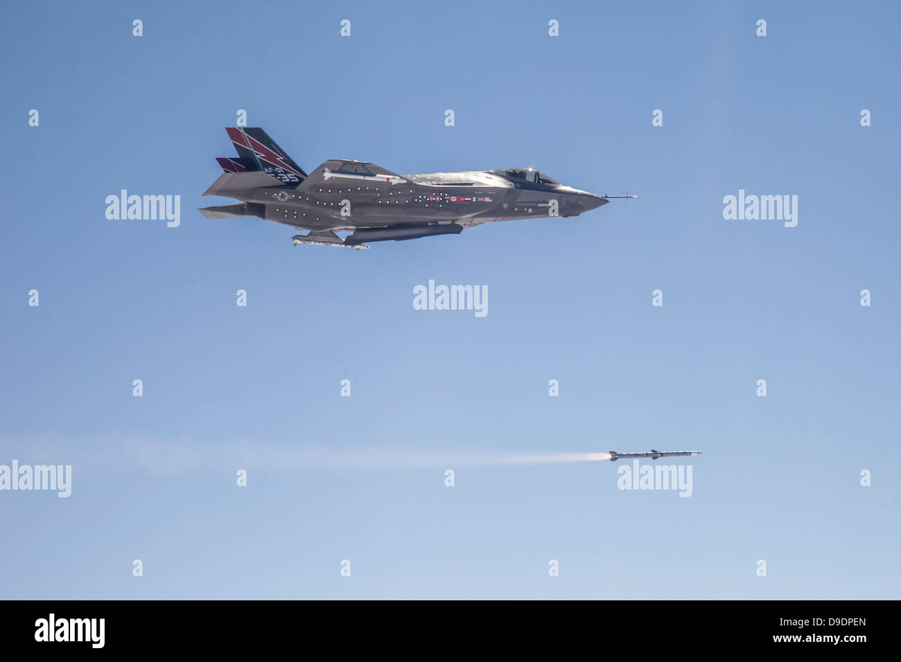 An F-35A conventional takeoff and landing (CTOL) aircraft conducts the first in-flight launch of an AIM-120 C5 missile. - Stock Image