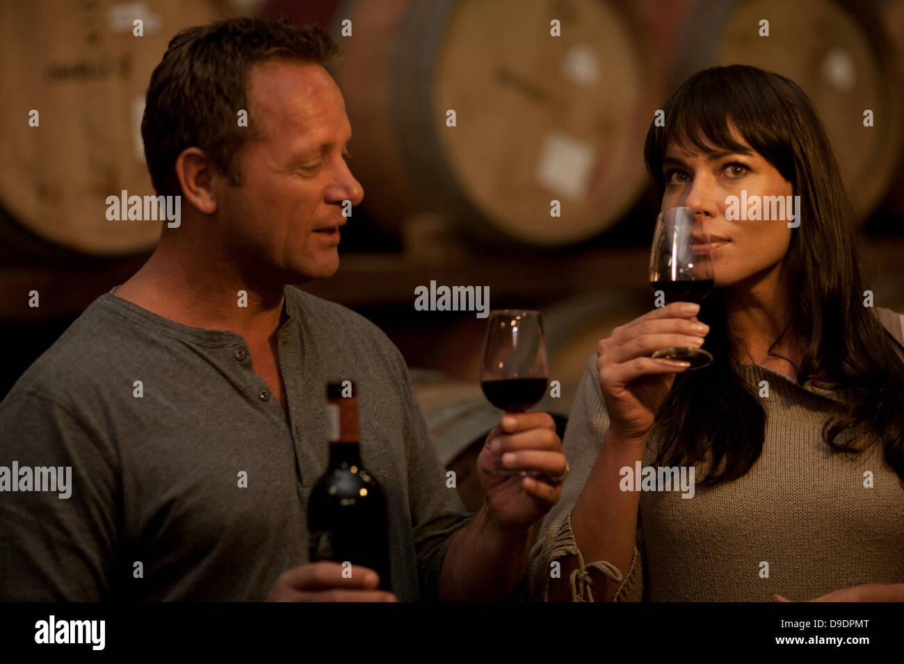 Sampling wine in barrels - Stock Image