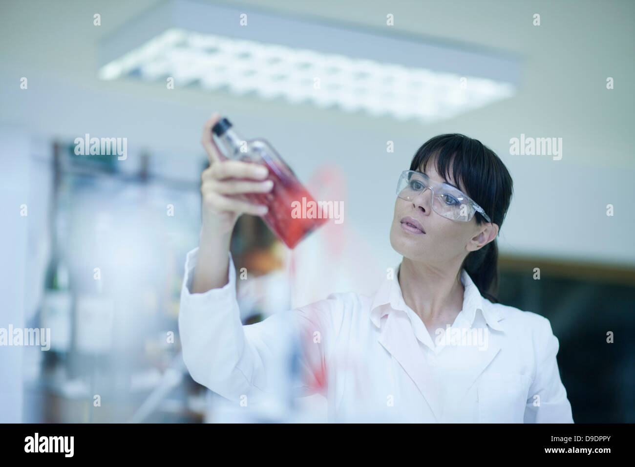 Oenologist monitoring sample testing in laboratory Stock