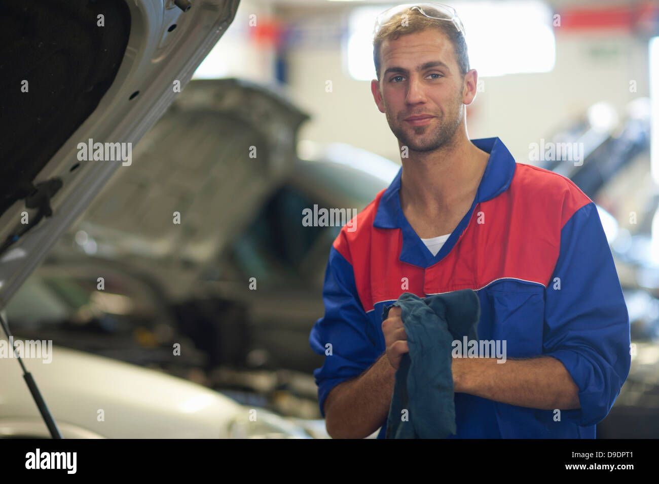 Car mechanic on completion of job - Stock Image