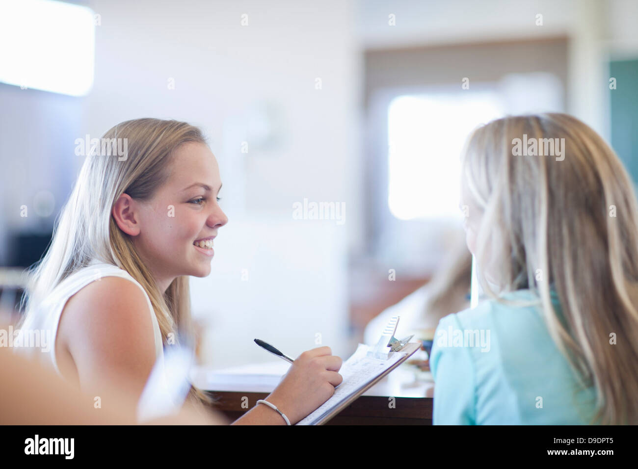 School girls in discussion - Stock Image