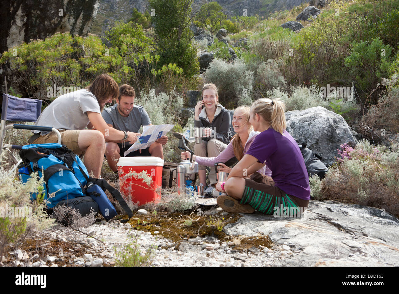 Young group of hikers taking a break - Stock Image