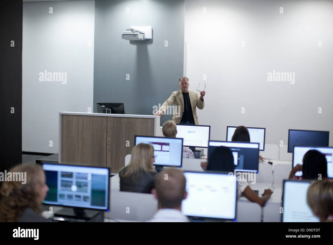 Students using computers in lecture - Stock Image