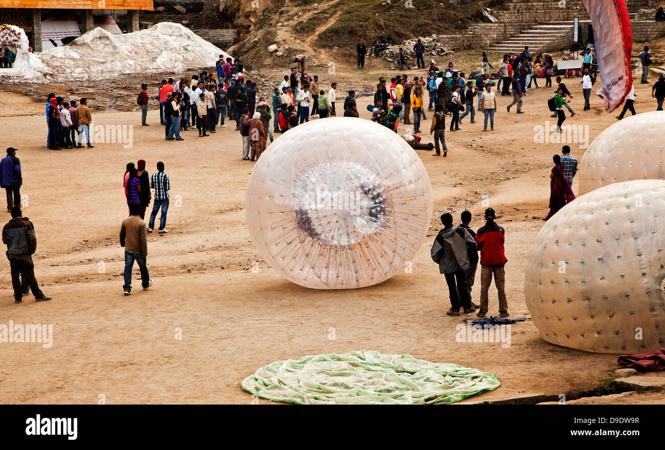 Tourists and Parachutes at a resort, Manali, Himachal Pradesh, India - Stock Image