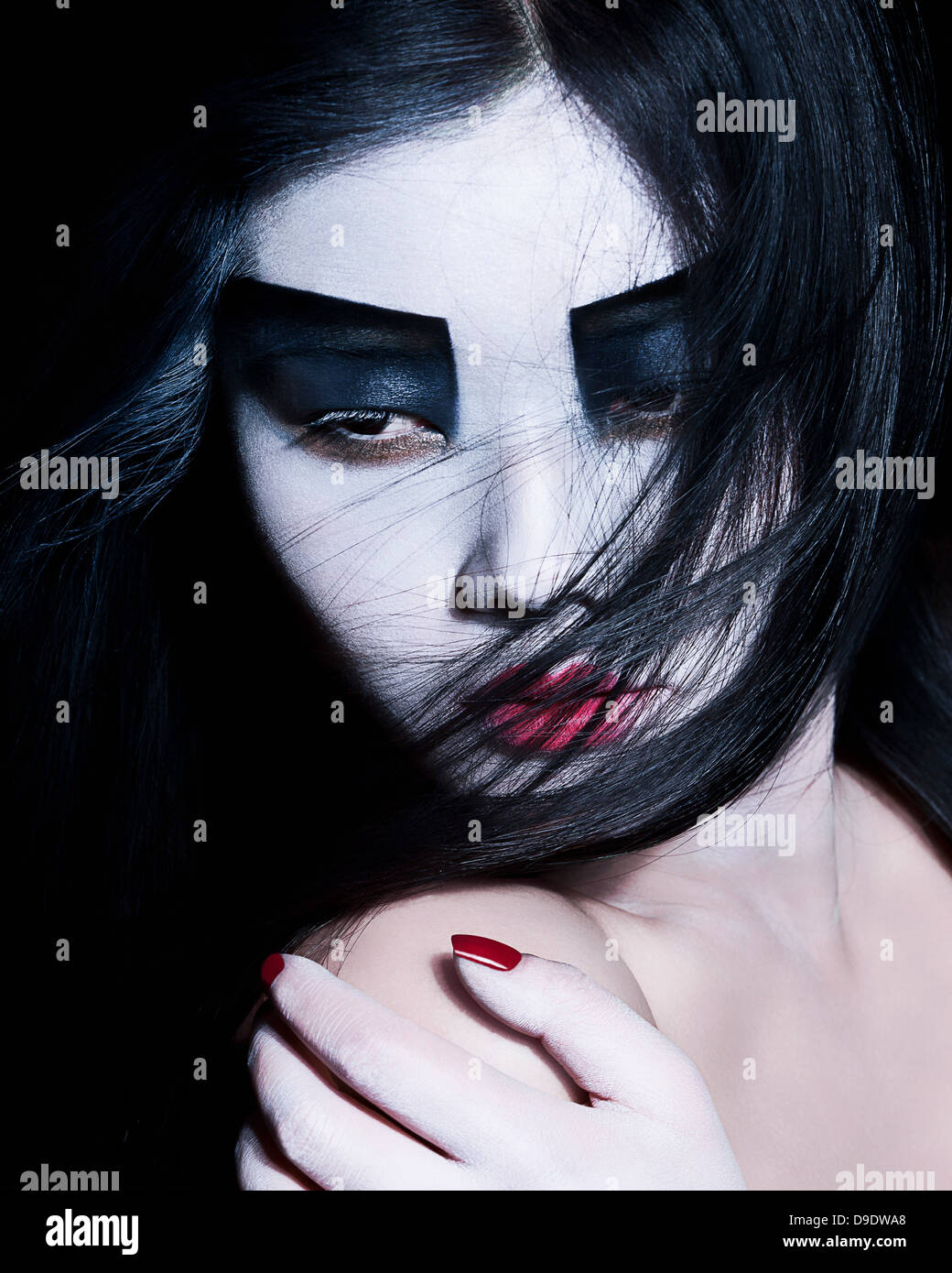 Young woman with dramatic makeup, black eyeshadow - Stock Image