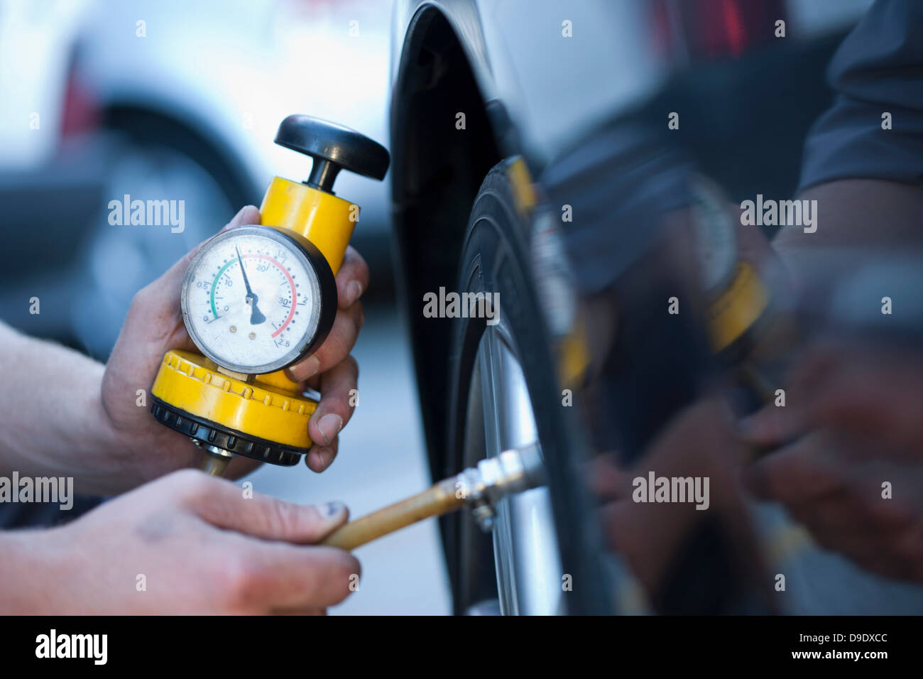 Person using pressure gauge - Stock Image