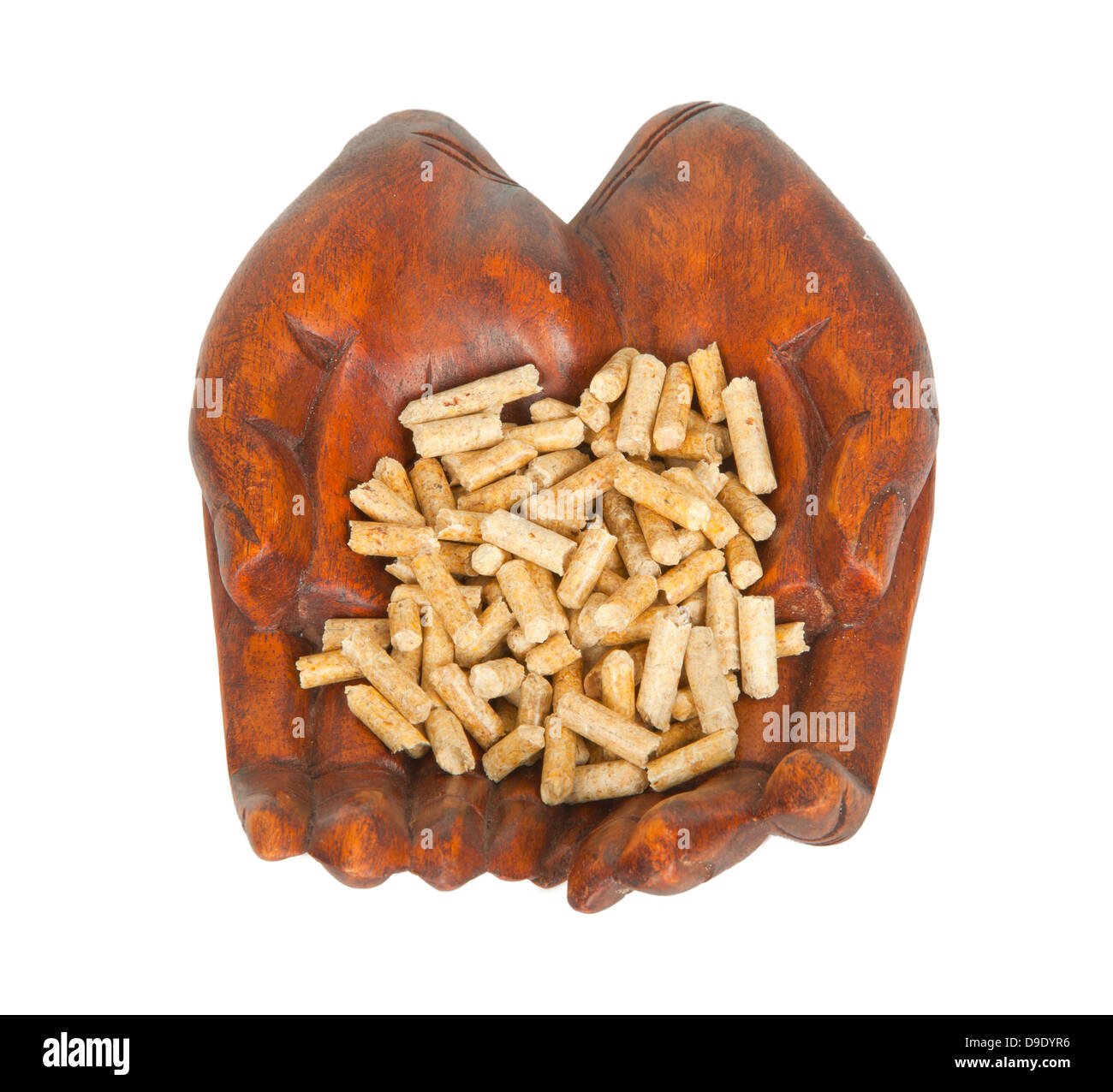Wood pellets in hand on white background - Stock Image