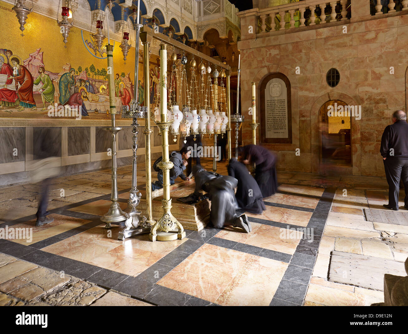 Stone of anointment in the Church of Holy Sepulchre in Jerusalem, Israel - Stock Image
