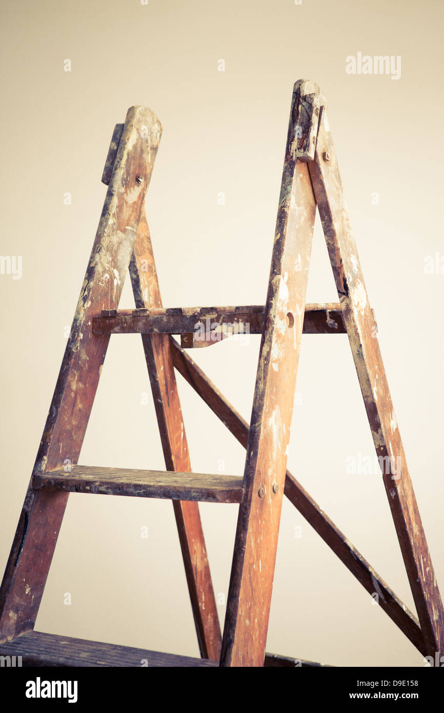 A wooden stepladder, placed in an empty room Stock Photo
