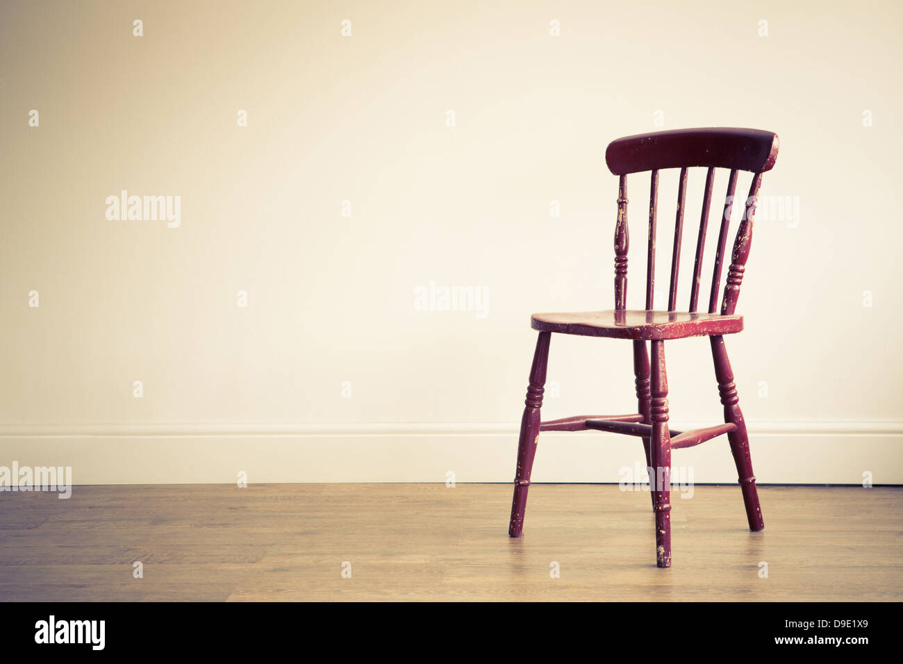 A Single Wooden Chair Placed In An Empty Room
